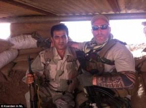 "A member of Dutch Biker Gang No Surrender, ""Ron,"" with a Kurdish fighter. (Photo credit: Koerden in NL)"