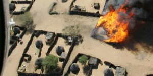The burning of Um Ziefa in Darfur, Sudan in 2004 (Photo credit: Brian Steidle for USHMM, cropped)